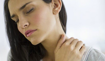 Woman at chiropractor with neck pain