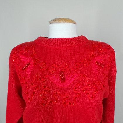 Rode trui met geborduurde details