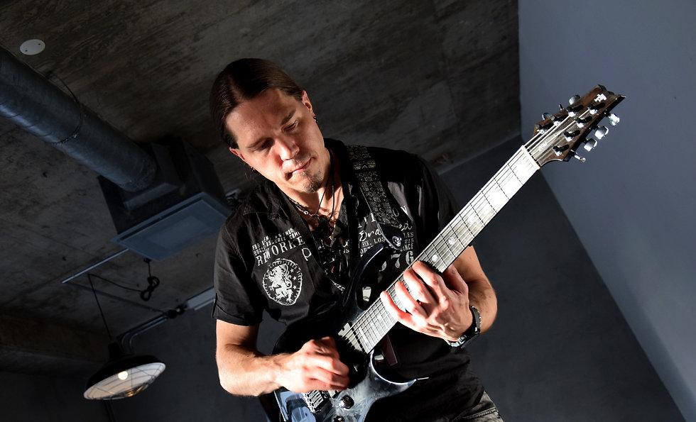 Samuli Federley V25-FX7/H custom guitar with yin-yean custom inlay set on fretboard