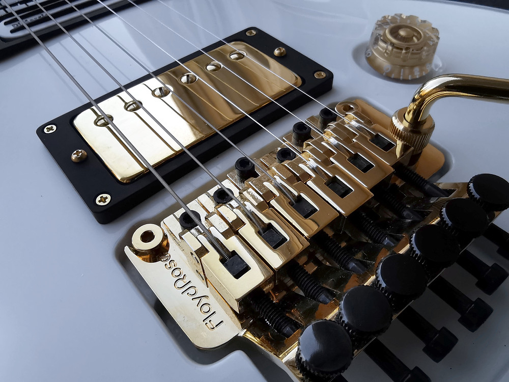 Original Floyd Rose tremolo system is featured in AROK-FR Shadowman guitar.  Here with gold finish like metal covered paickups