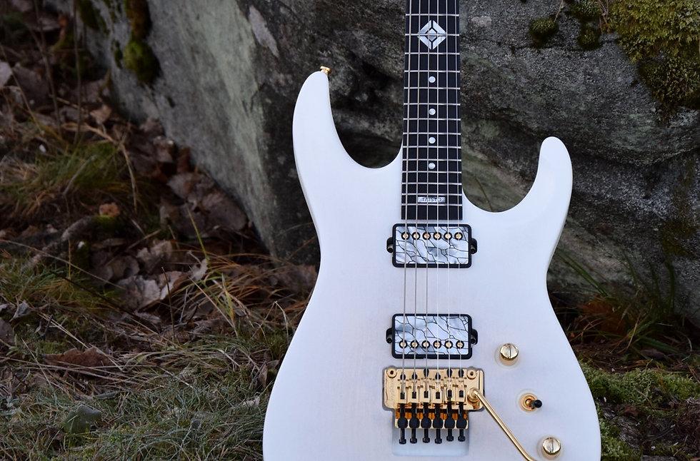 Taisto Guitars V25-FR plus2 baritone guitar with arctic white satin finish