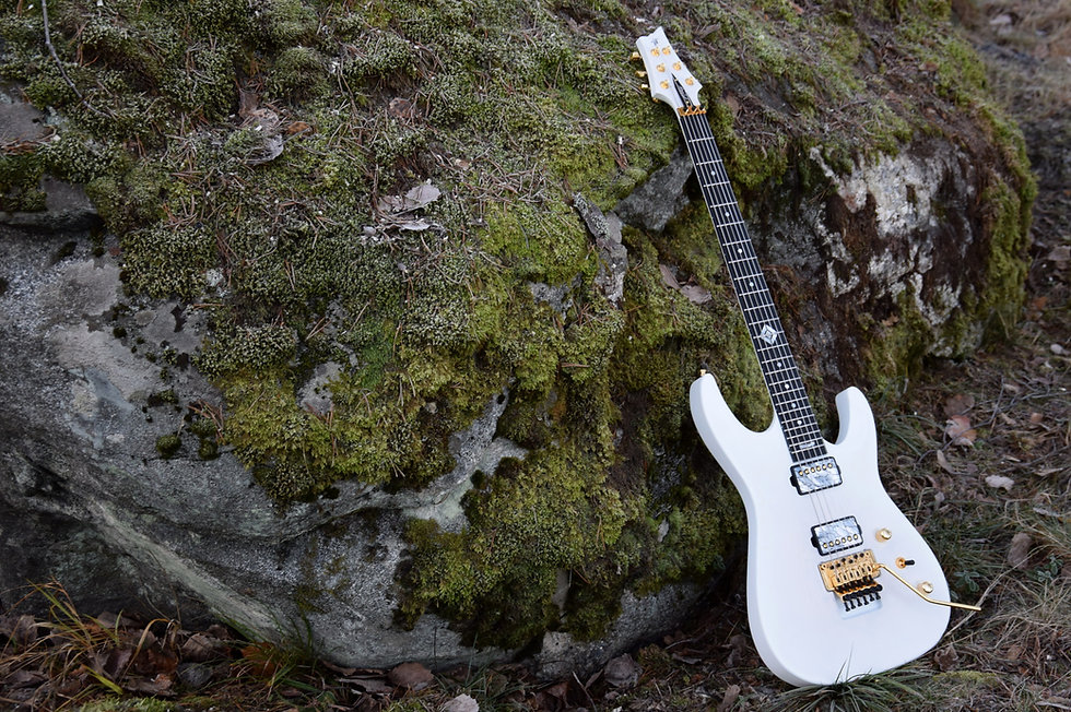 Taisto Guitars white V25-FR plus2 custom guitars with Lundgren The One pickups covered with TAISTO Cracked Ice pickup covers