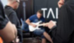 Guitar testing at Fuzz Guitar Show in Gothenburg Sweden