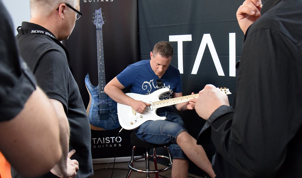 Guitar testing at Fuzz Guitar Show in Gothenburg Sweden