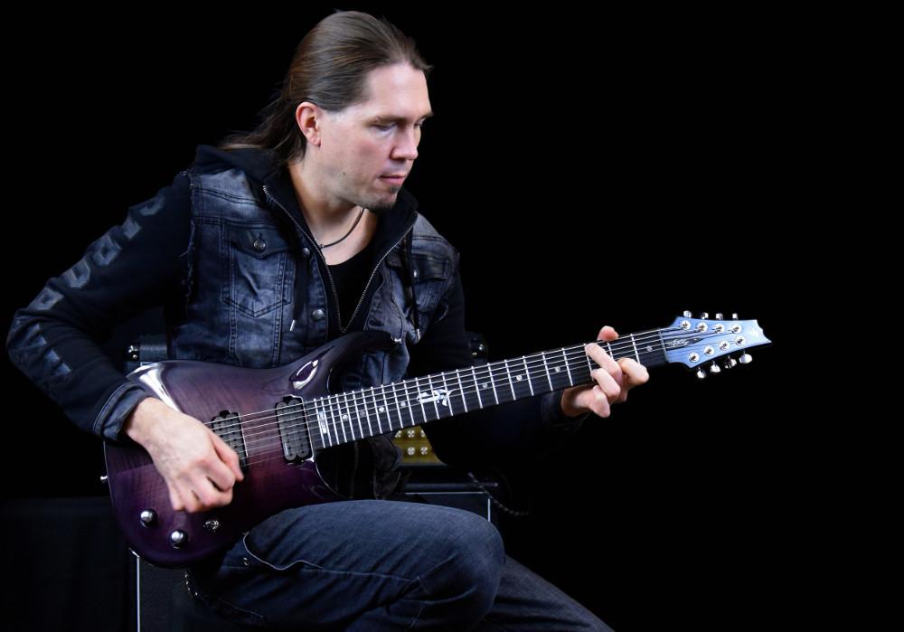 Samuli Federley with Taisto Guitars V25-FX8/H Skyfire guitar