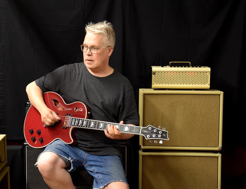 Taisto with AROK-WG custom guitar