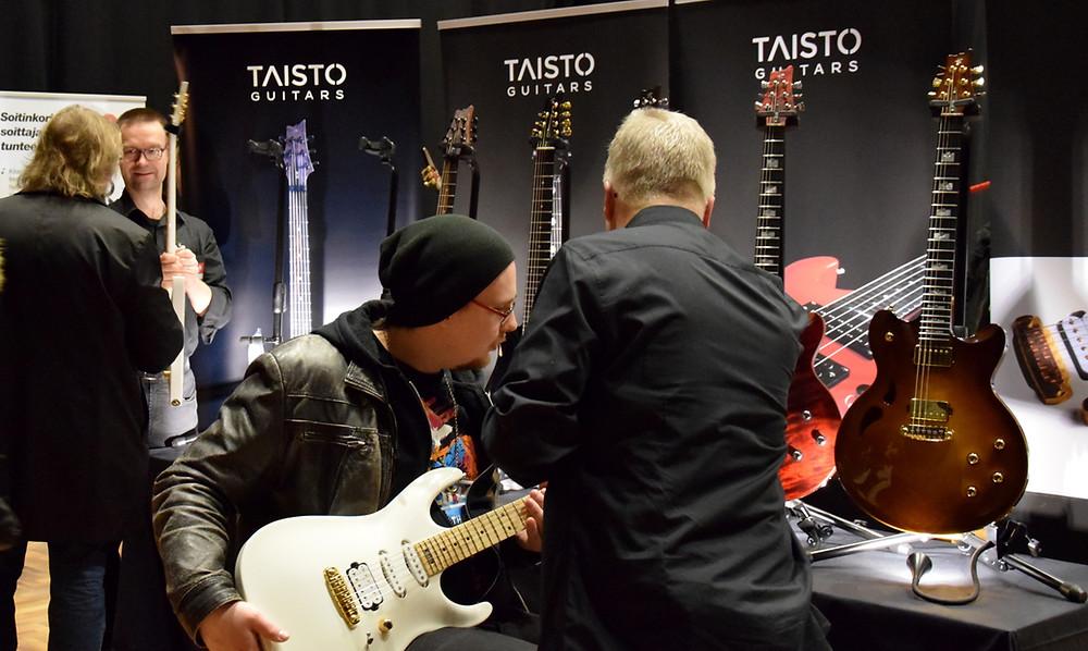 Taisto Guitars booth visitors in Helsinki Tonefest 2019