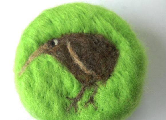 Felted Kiwi on Green Background