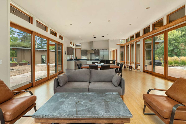 Great-Room-Flanked-By-Walls-Of-Windows.j