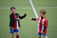 boys playing soccer.jpeg