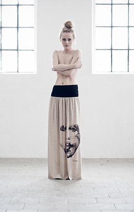 Woman's-maxi-skirt-with-hand painted-face-motive-printed-on-high-quality-cotton-by-Ewa-Zwolinska.