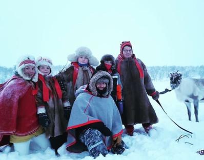 Happy travelers with the Sami reindeer herders