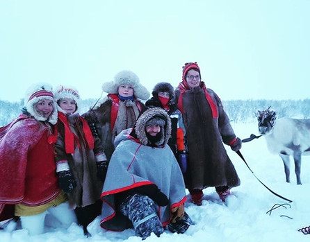 Happy travelers with the Sami reindeer herders