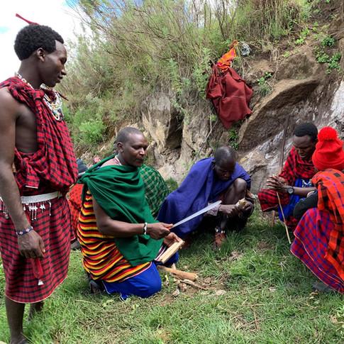 Maasai men prepairing Maasai barbecue in Ngorongoro, Tanzania