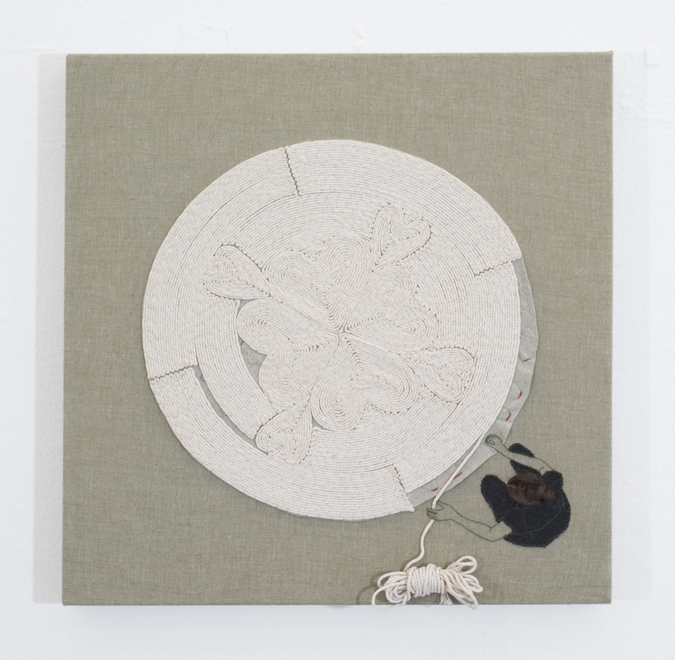 Cording rug with secret embroidery