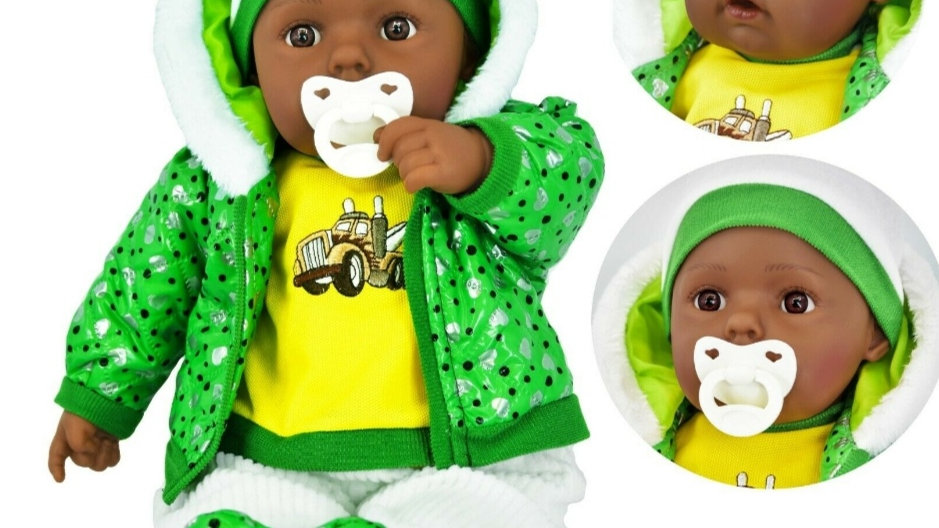 Black boy doll. Green and yellow clothing