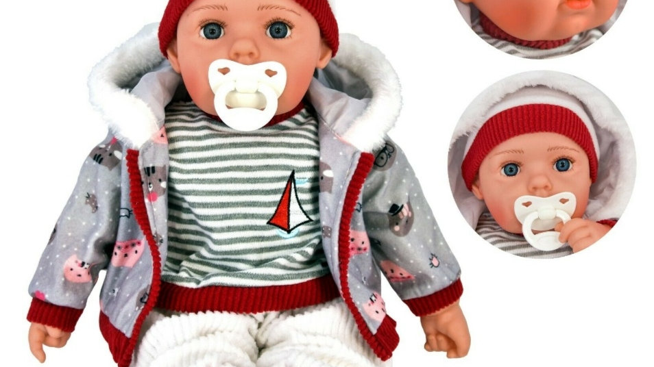 Grey and red boy doll