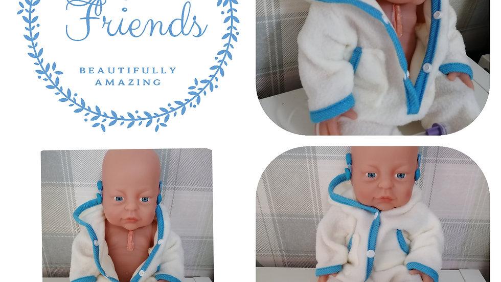 Hearing aids, heart scar, feeding tube boy doll