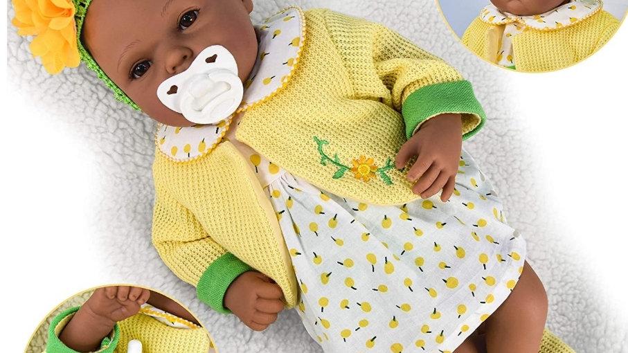 Black doll yellow clothing