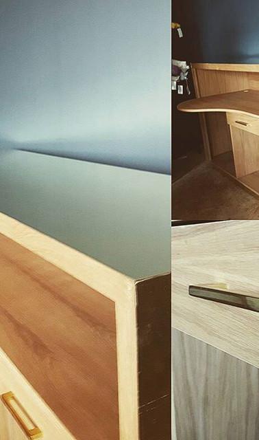 Oak and brass reception desk designed fo
