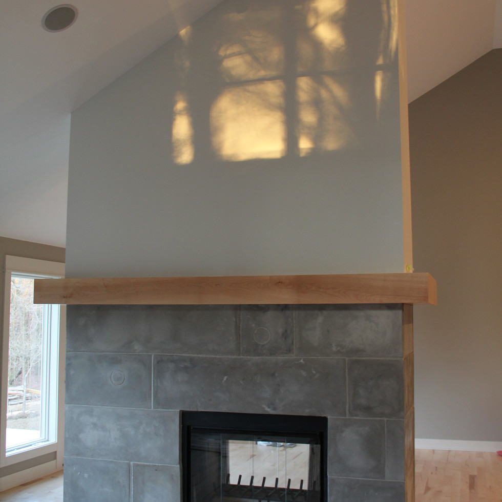 Indoor double sided concrete fireplace
