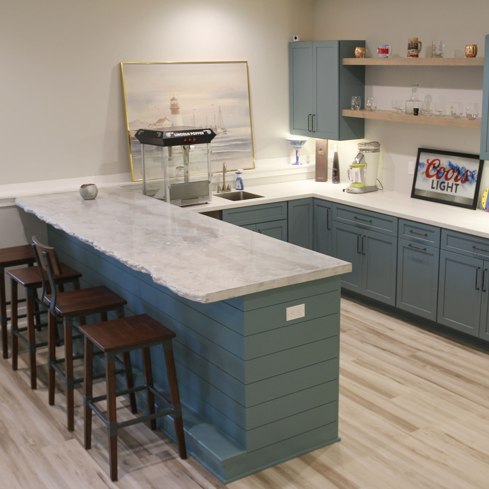 Large concrete counter for bar in a residential home