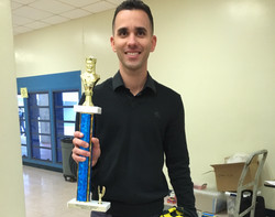 Student Pedro receives trophy