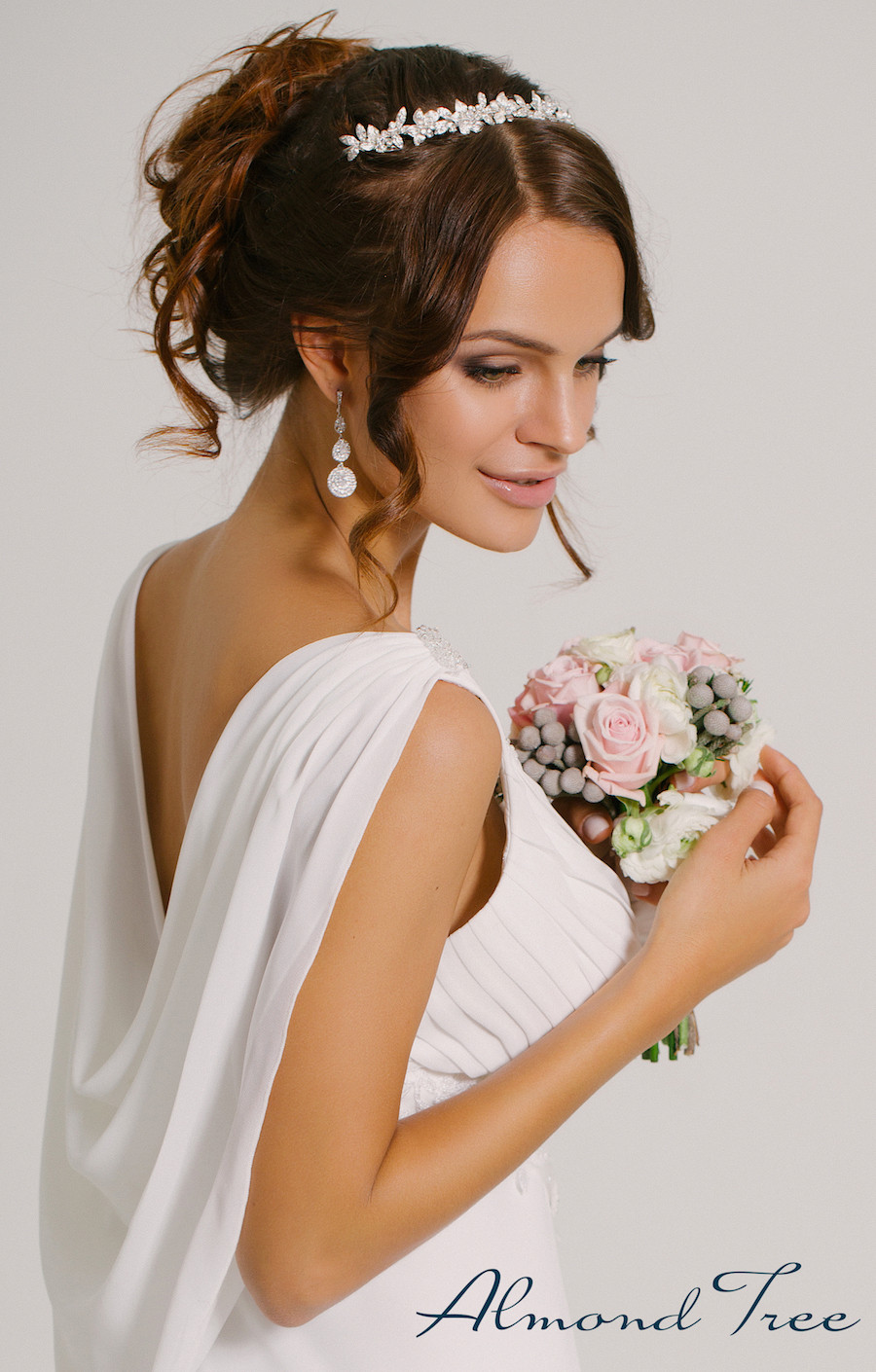 Beautiful Happy Bride in White Bridal Wedding Dress from Almond Tree Wedding Boutique