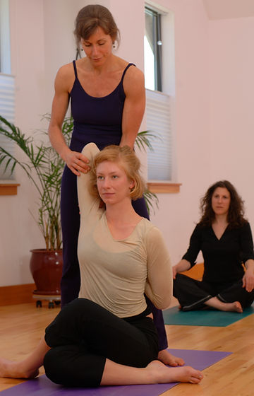 Yoga instructor and students.jpg
