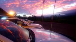 Mine site trucks as the sun sets