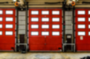 Red Fire Station doors closed at a fire