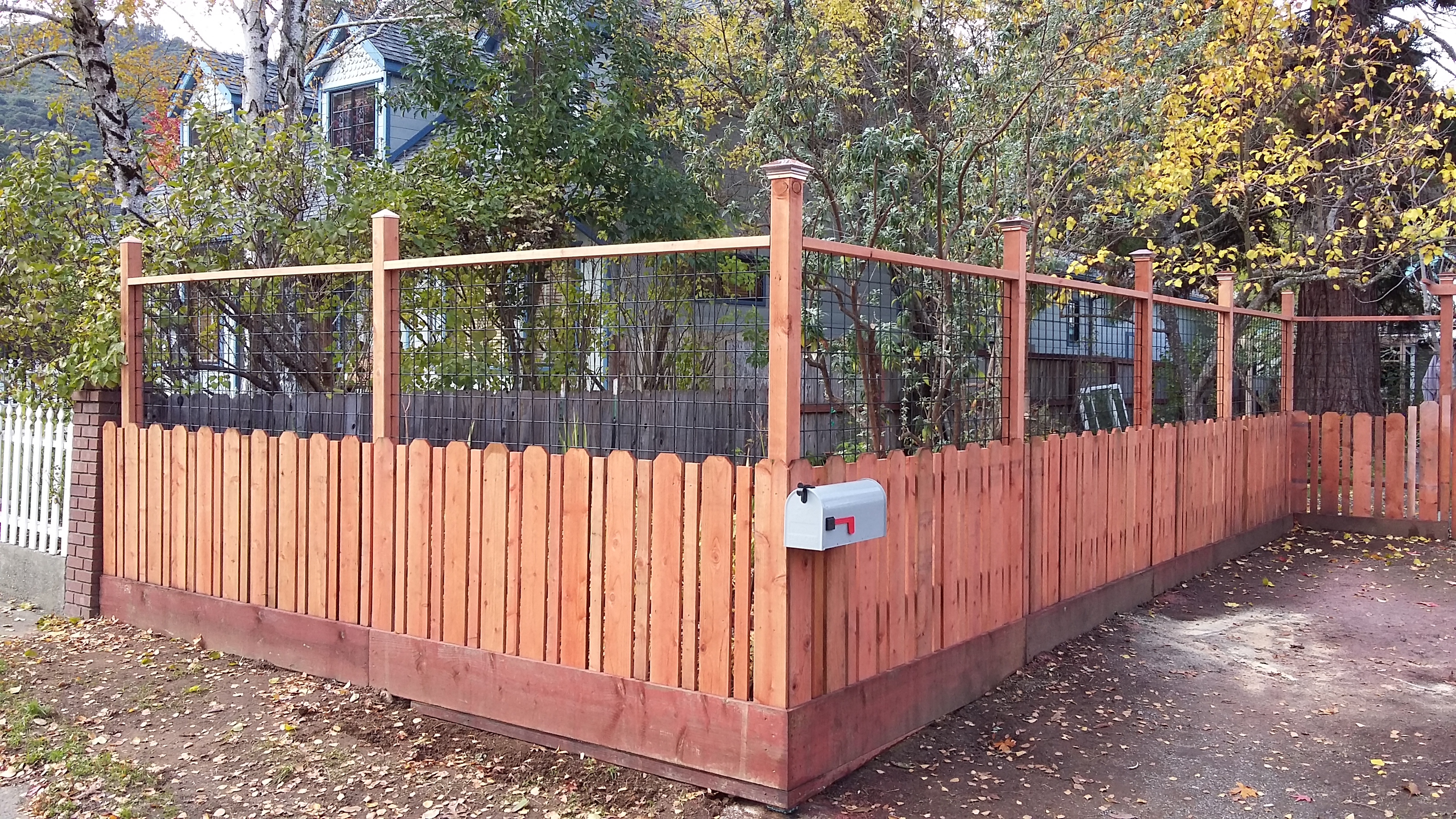 Redwood fence with hog wire