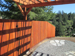 Pergola and redwood fence