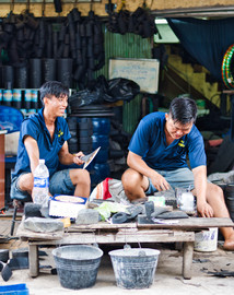 These 2 men spend all day carving up old tyres to make many things of the rubber. It is the best type of recycling.