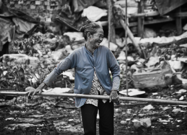 Although she is pushing 70, this woman still scours the rubbish pits for any excess plastic that she might sell.