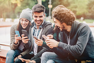 Group of people using social media to share and like images.