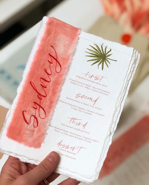 Tie dye fabric wedding menus