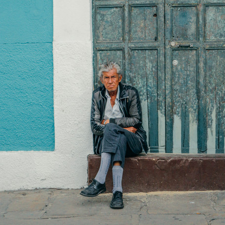 Man sitting on doorstep. Bogota, Colombia