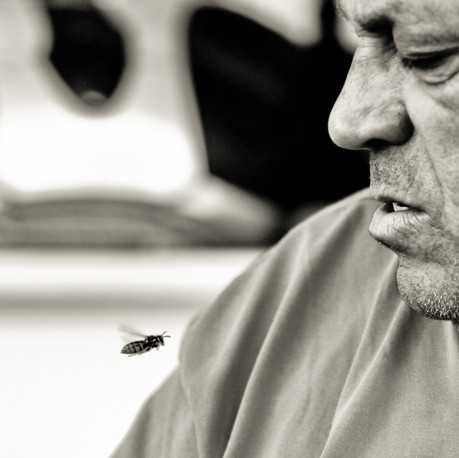 Uncle Tasos and a flying bee. Larissa, Greece