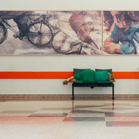Woman sleeping in hospital corridor. Larissa, Greece