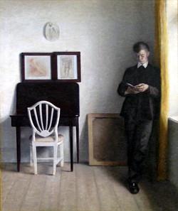 1898 Interiør med læsende_ung_mand