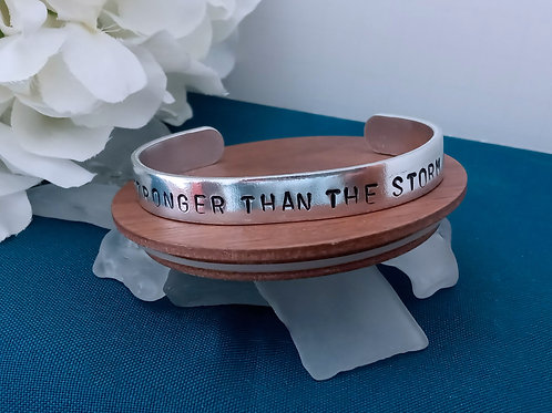 Hand Stamped Aluminum Cuff Bracelet - Stronger Than The Storm