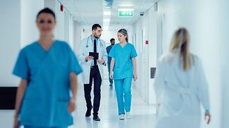 Surgeon and Female Doctor Walk Through H