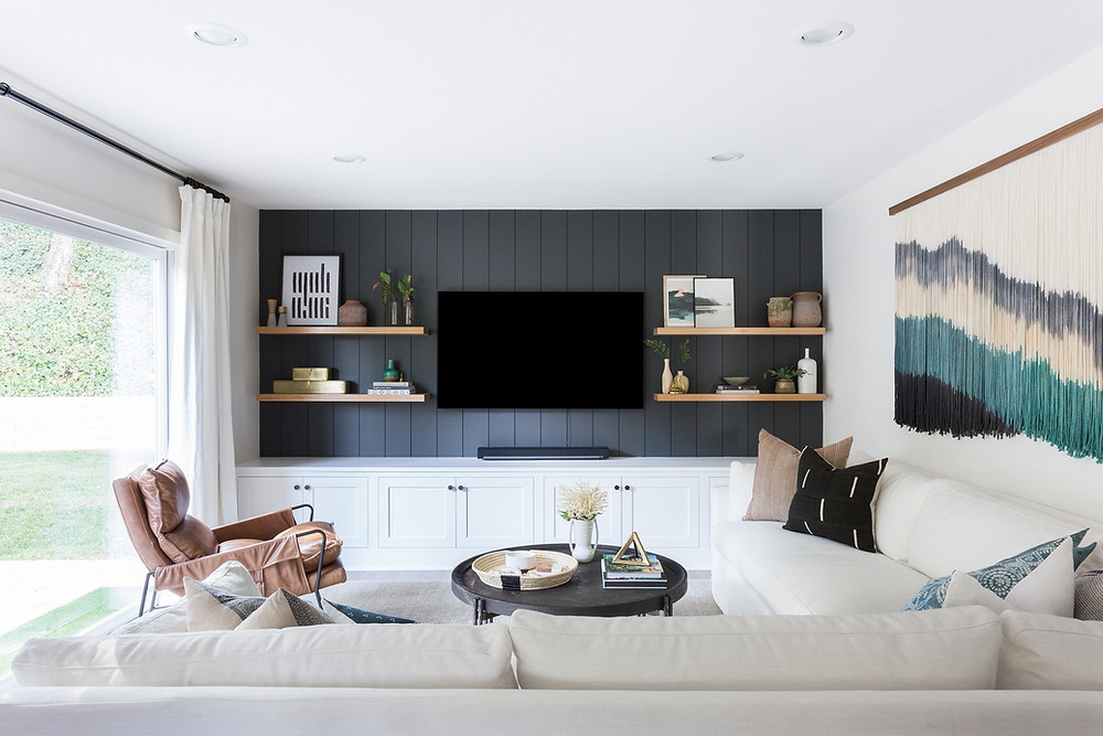 family room with dark painted vertical paneling