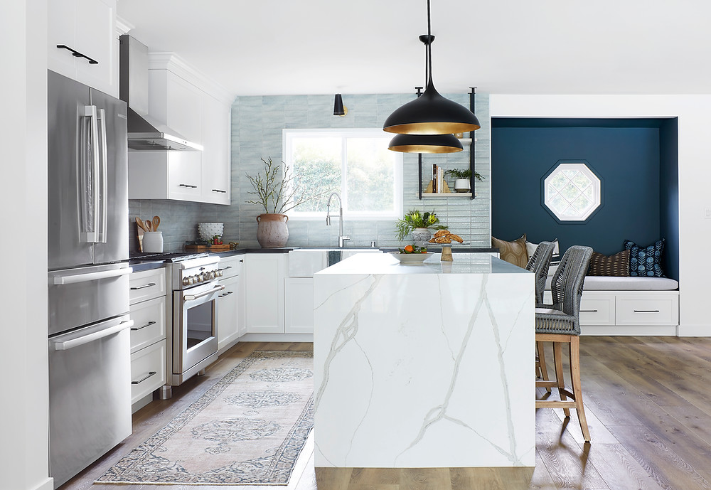 kitchen with waterfall counter and blue subway tile