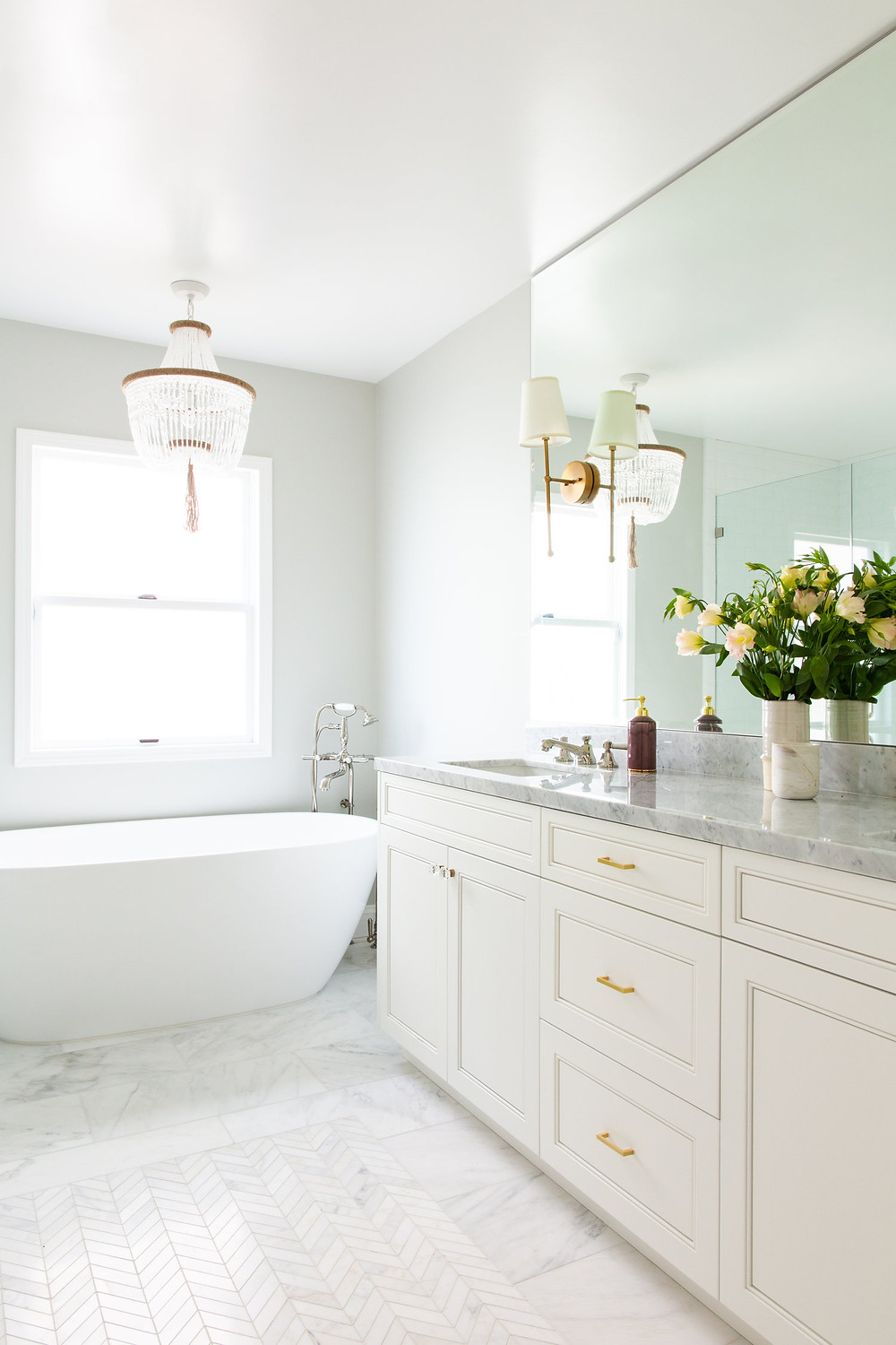 bathroom with marble by Lindsey Brooke Design