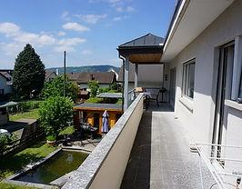 Long south-facing balcony in front of li