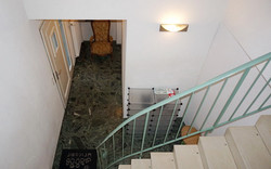 Entrance, stairs to apartment
