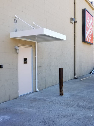 Aluminum architectural awning w/ rod tie backs