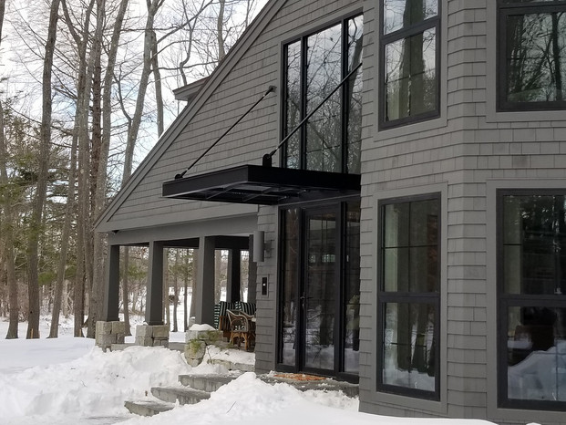 Metal & glass architectural awning w/ rod tie backs